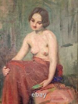 Élégante huile sur toile représentant une femme dévêtue, signée Augusta LAFITAU
